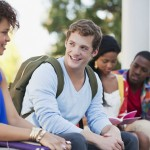 Smiling students talking outdoors